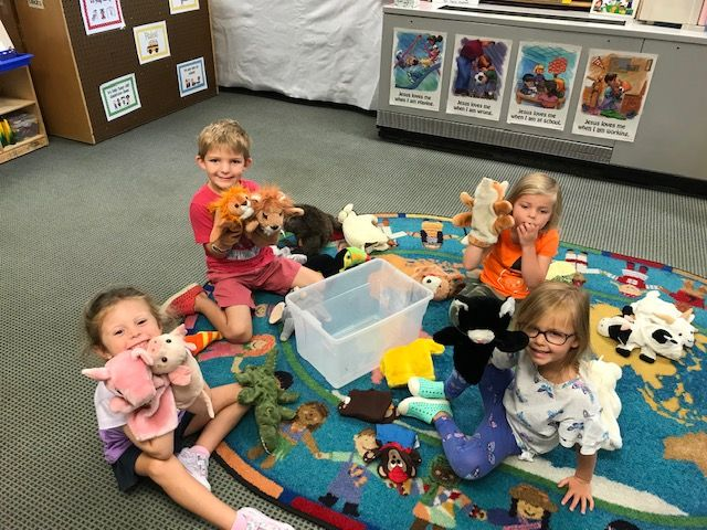 Preschool students playing with hand puppets